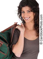 kvinna, bärande väska, av, handtag