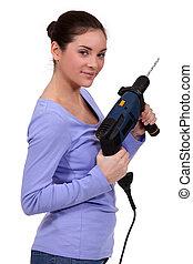 kvinna, elektrisk borrmaskin