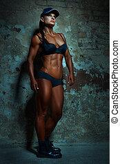 kvinna, framställ, med, stor, muscles.