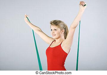 kvinna, gör, sports, med, gummi musikkår