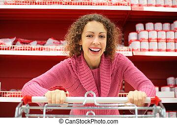 kvinna handling, kärra, supermarket