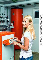 kvinna, in, den, varmvattensberedare rum, för, heating.