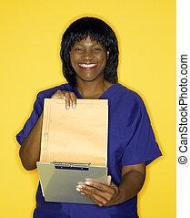 kvinna, in, läkar uniformera, läsning, chart.