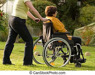 kvinna, in, rullstol