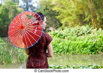kvinna, japanska trädgård
