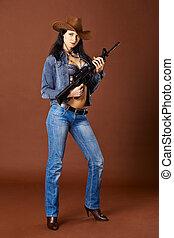 kvinna, jeans, ung, holdingen, gevär
