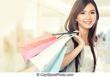 kvinna, lycklig, med, handling väska