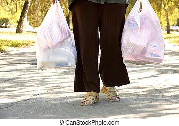kvinna, med, mycket, av, packar