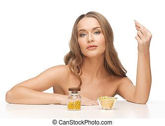 kvinna, med, vitamins