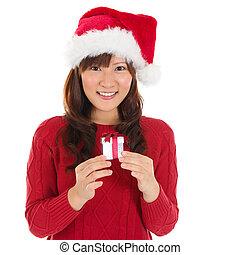kvinna räcka, gåva, jultomten hatt, jul