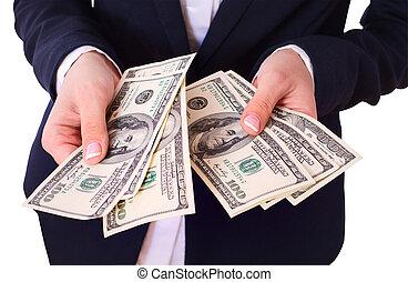 kvinna räcka, kontanter, dollars, in, hand.