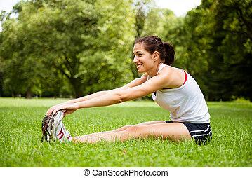 kvinna sträckande, -, frilufts reko kille, övning