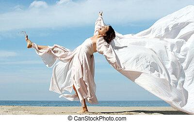kvinna, stranden