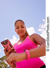 kvinna, syncronizes, fitness, ur, med, ringa