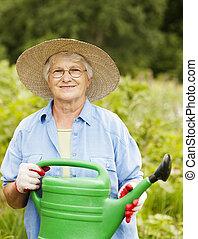 kvinna, vattning kunna, holdingen, senior