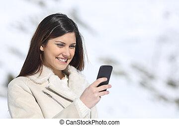 kvinna, vinter, lov, ringa, användande, smart