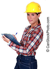 kvinnlig, övervakare, hållande skrivplatta