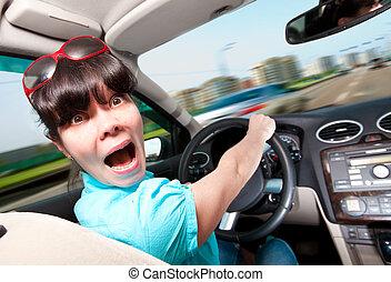 kvinnor, driva en bil