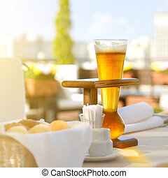 Kwak beer on the served table. Outdoors photo.