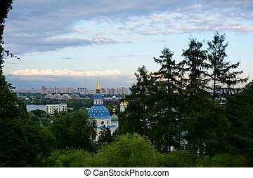 Kyiv cityscape with orthodox church and monastery