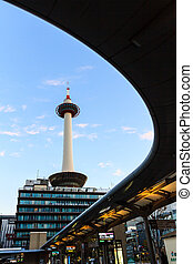 Kyoto tower with dark sky in Japan.