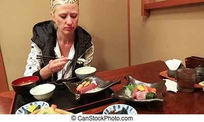 Kyoto Japanese restaurant - woman eating rice with ...