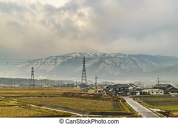 KYOTO, JAPAN, JANUARY - 2019 - Kyoto prefecture winter landscape scene from window train point of view