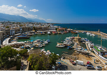 Kyrenia (Girne), Northern Cyprus - October 03, 2019: Old harbour of Kyrenia (Girne) and medieval fortress