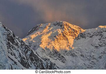 Kyrgyzstan mountains - Scenic Pik Pobeda peak lit by early ...