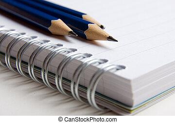 lápices, almohadilla