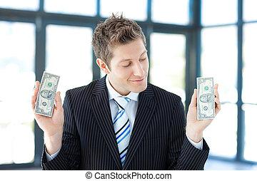 lächeln, geschäftsmann, haltend geld