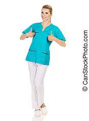 lächelnder fraudoktor, oder, krankenschwester, mit, daumen