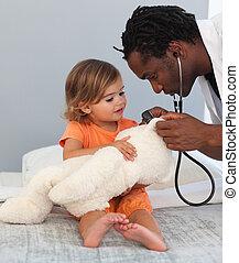 läkare, med, a, barn, in, a, sjukhus