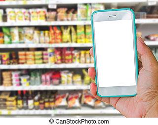 lämna rättvist, holdingen, grön, nit skärma, rörlig telefonera, med, supermarket, fläck, bakgrund, direktanslutet shoppa, begrepp
