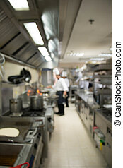 l kitchen of a restaurant, hotel or hospital with busy cooks working.