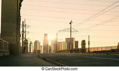 LA at Dusk Time-lapse - The sun sets behind the skyline as...