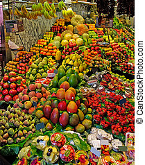 La Boqueria fruits stall. World famous Barcelona market, Spain.