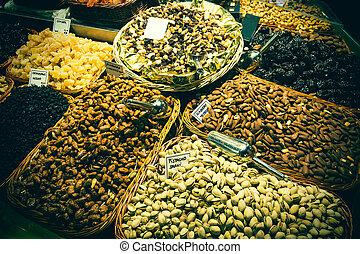 La Boqueria - Dry fruits stall in the Boqueria market in...
