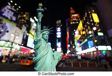 la estatua de la libertad, y, tiempos cuadran