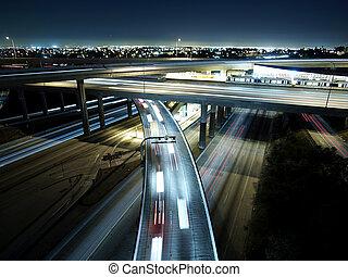Los Angeles Freeway interchange late at night.
