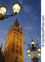 """La Giralda is one of the most famous landmarks in Seville. Once minaret of the ancient Seville mosque, it's been used by the Christians as a bell tower and an observatory since the 13th century. View of the tower from """"Plaza virgen de los reyes"""". Photo taken on the 27th of September, 2009."""