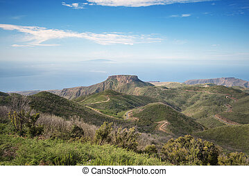 La Gomera landscape viewed from the highest point of the island, El Hierro island is in the background, Canary island, Spain.