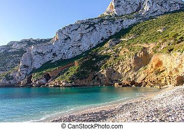 La Granadella beach in Javea, Spain, on a sunny day