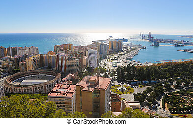 Panorama on the port of Malaga, Andalusia, Spain, with the famous bullring La Malagueta on the left.