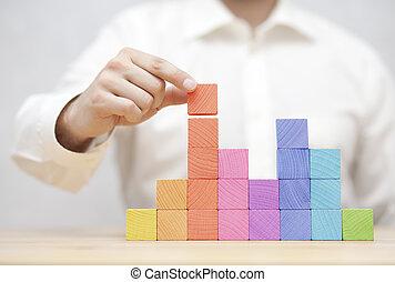 la mano de hombre, amontonar, colorido, de madera, blocks., desarrollo negocio, concepto