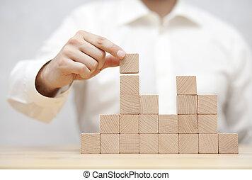 la mano de hombre, amontonar, de madera, blocks., desarrollo negocio, concepto