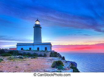 La Mola Cape Lighthouse Formentera at sunrise in Balearic...