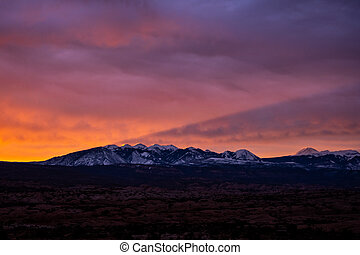 La Sal Mountains Cast Shadow In The Sky At Sunrise