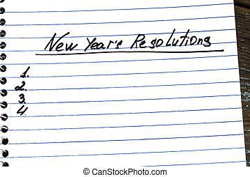 la solución del nuevo año, escrito, en, un, bloc, close-up., año nuevo, resolutions, concepto