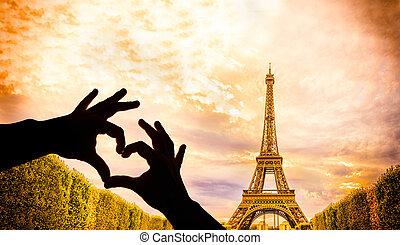 la torre eiffel, en, parís, y, manos, en, un, forma corazón